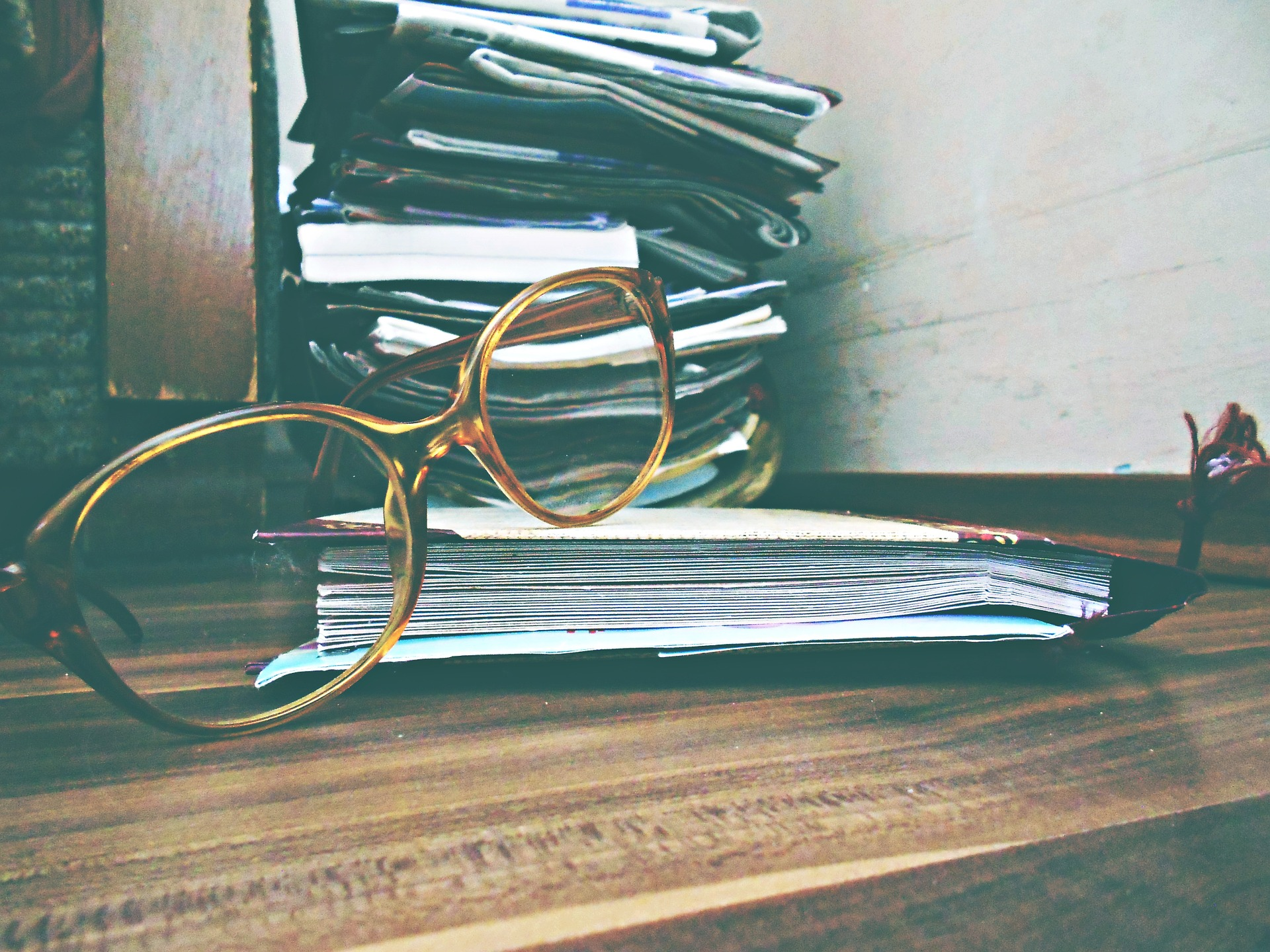 Glasses and stack of paper